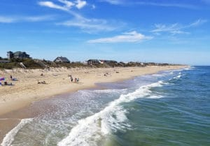 view of the beach and ocean with a blue sky in the Outer Banks of North Carolina