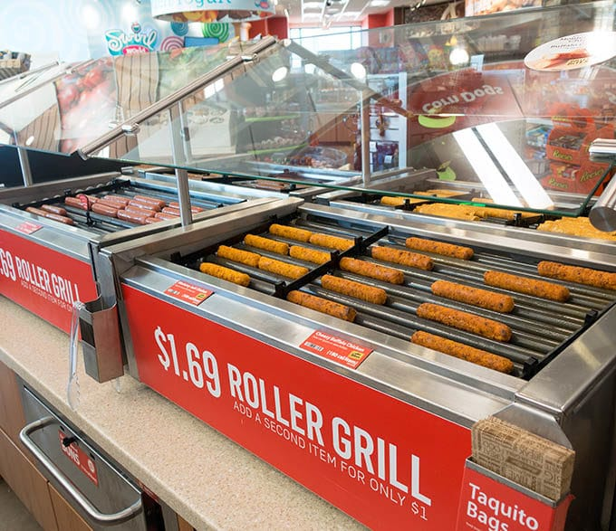 grillers with a variety of hot dogs on the rollers at RaceTrac