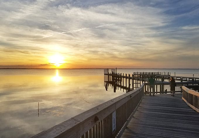 view of a sunset off a dock on in the Outer Banks