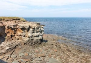 Cliffs in Caraquet, New Brunswick overlooking the St. Lawerence Bay and a slate covered shoreline