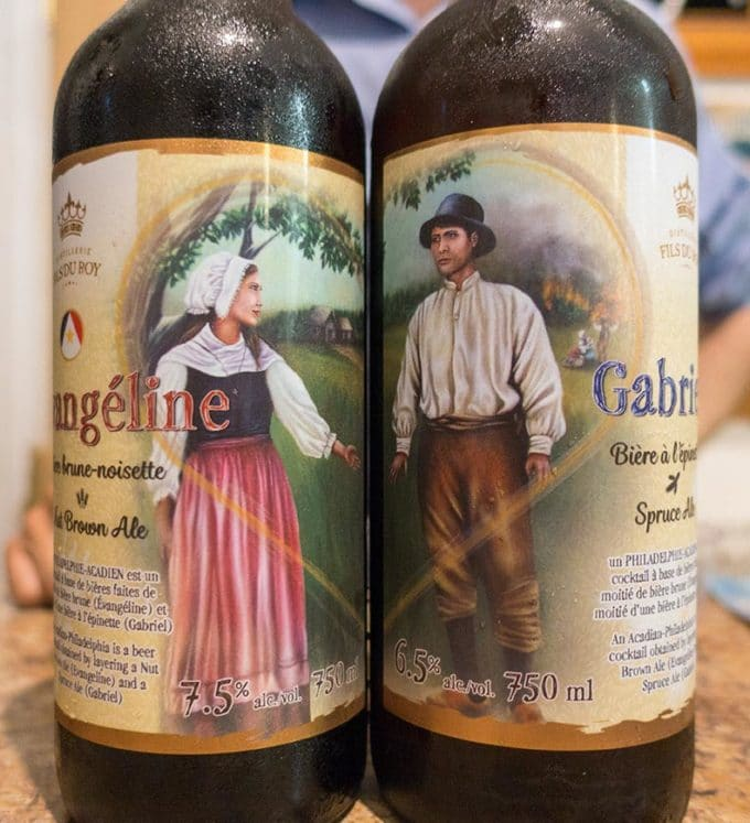 pictures of a man and a woman, each on a beer bottle dressed in 18th century clothing