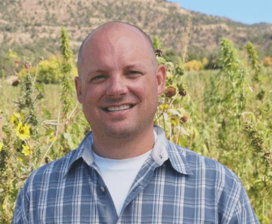 Charles Garden Stivers in a hemp field in Colorado