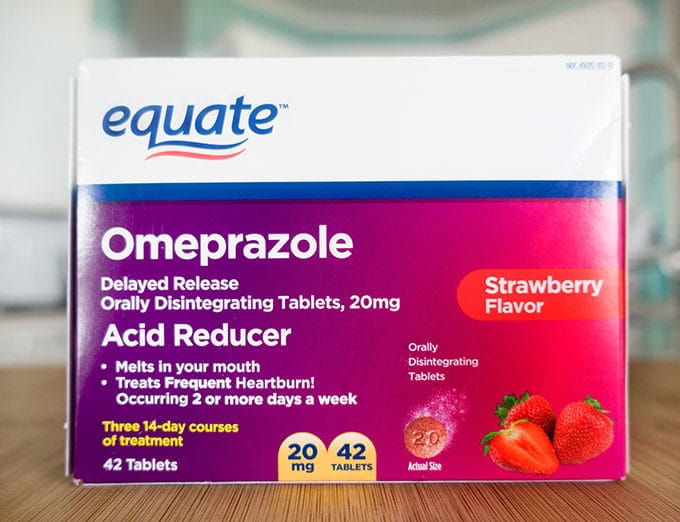 box of Omeprazole ODT sitting on a cutting board in a kitchen