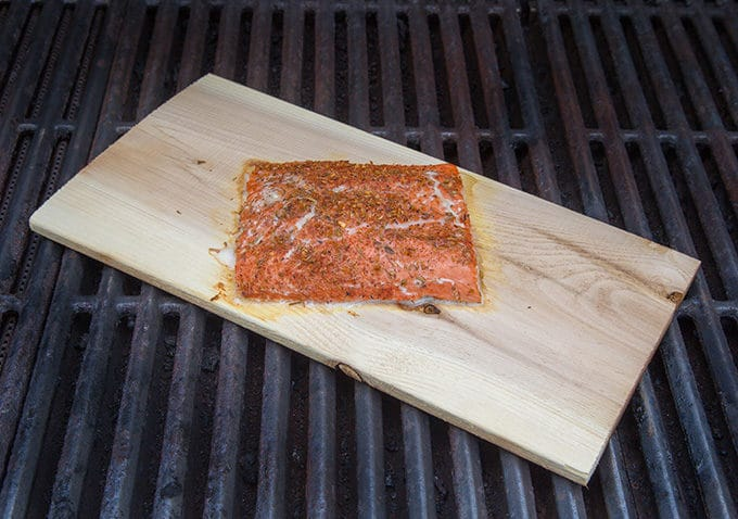cooked seasoned planked salmon on a diagonal on a grill