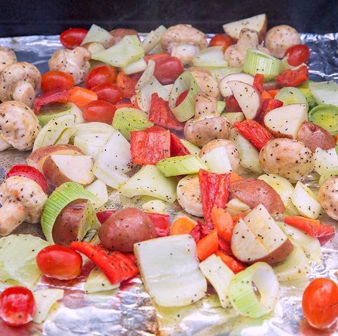 cut vegetables on aluminum foil on the grill