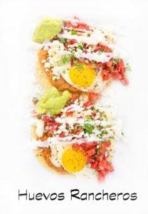2 portions of huevos rancheros on a white platter