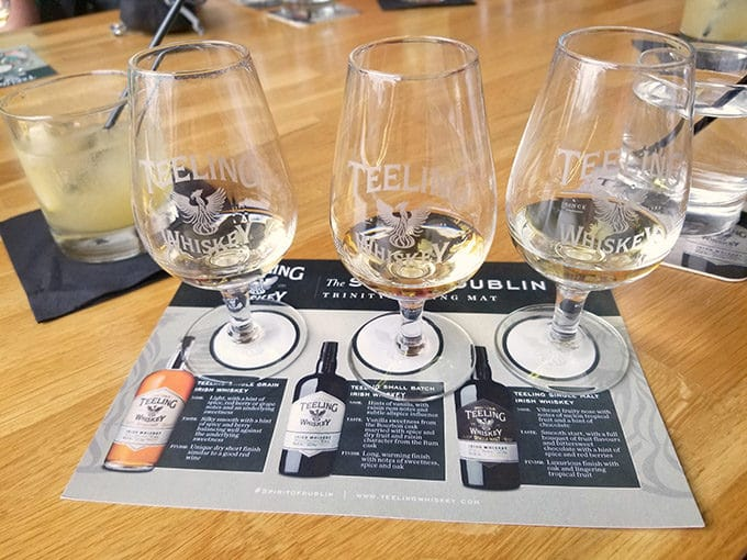 3 glasses of Teeling Whiskey with descriptions for sampling at the Telling Whiskey Distillery in Dublin Ireland