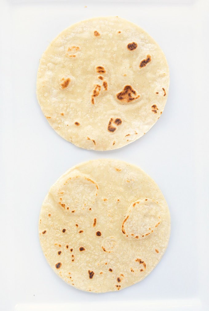 grilled tortillas on a white platter