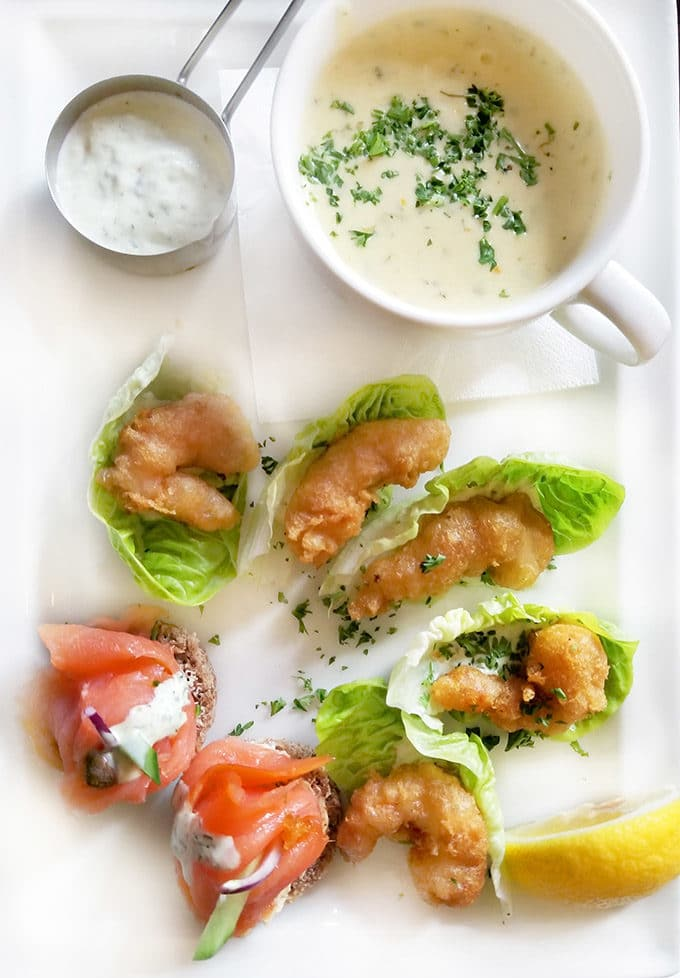 a mug of chowder, tempura shrimp on lettuce leaves and smoked salmon on toasts o a white platter at Abbey 's Tavern in Howth Ireland