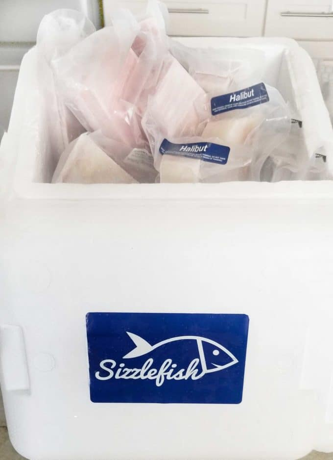 styrofoam shipping container with tuna and halibut individually wrapped and frozen from Sizzlefish