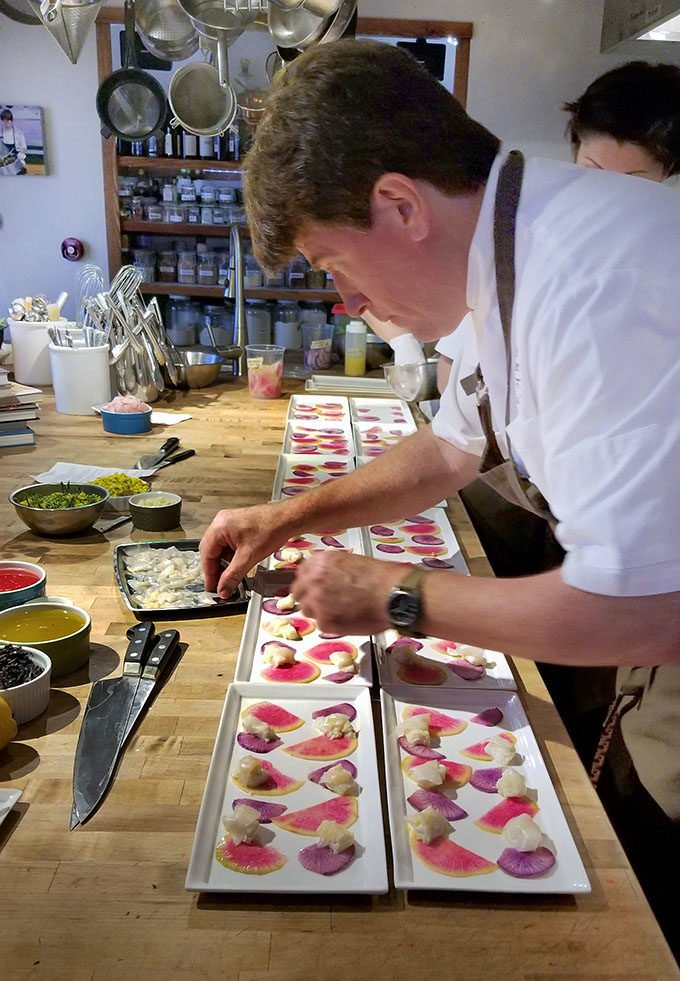 Vincent Nattress, Chef/Owner of the Orchard Kitchen working in his kitchen creating appetizers