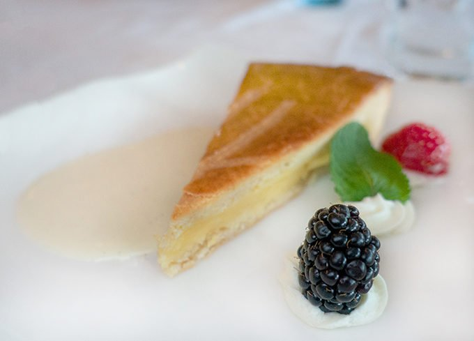 slice of a Basque Cake on a white plate with berries
