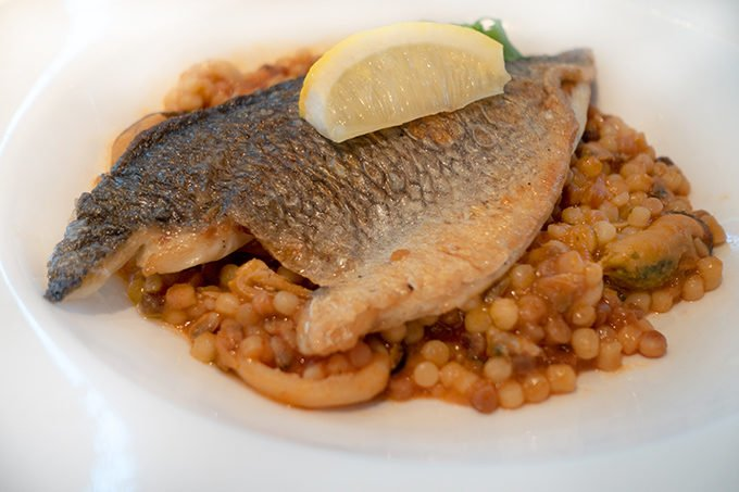 seared dorado with skin on served on a bed of fregola