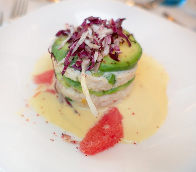 crab and avocado salad with grapefruit on a white plate