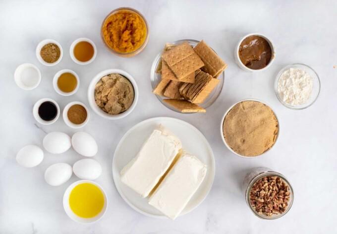 ingredients to make a pumpkin praline cheesecake
