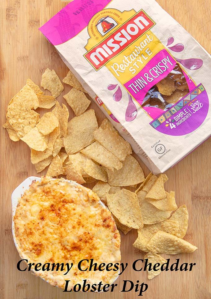 Cheddar Lobster Dip with Mission Tortilla chips on a cutting board