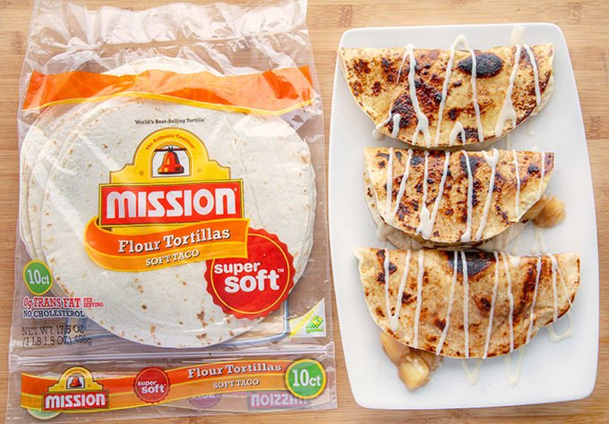 apple pie fold overs next to a package of mission flour tortillas