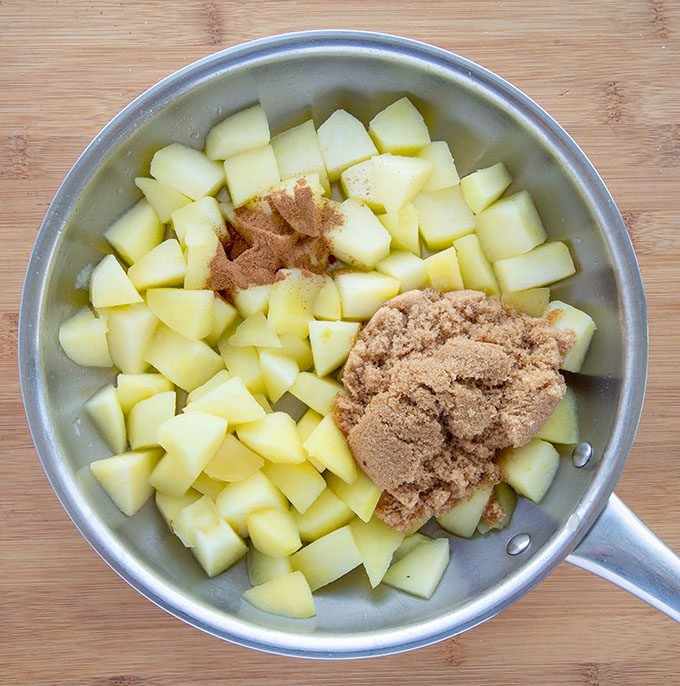 apples ina saute pan with brown sugar and cinnamon
