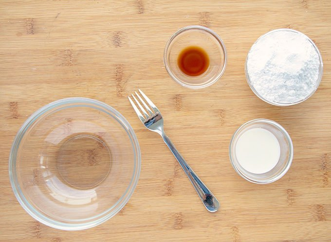 ingredients in glass bowls to make glaze for apple pie fold-overs