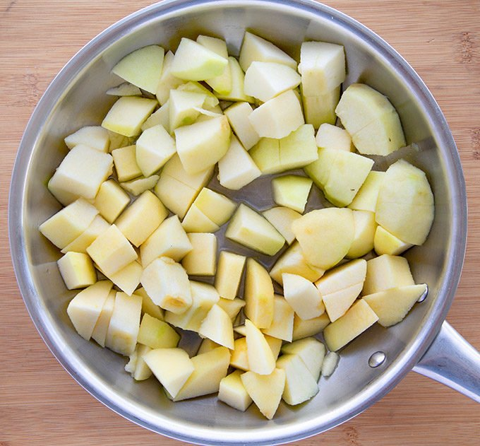 cut apples in a saute pan with water