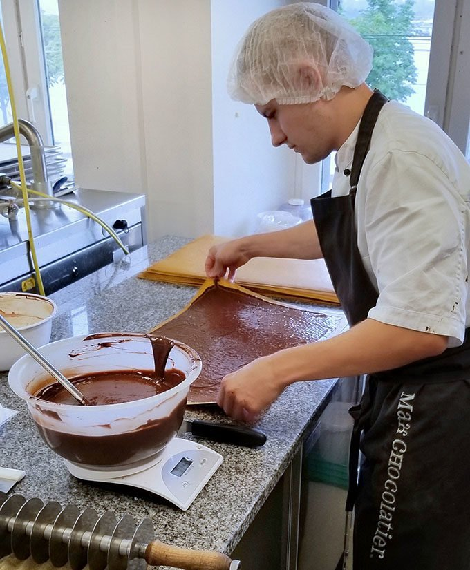 young man working with chocolate at Max Chocolatier in Lucerne Switzerland