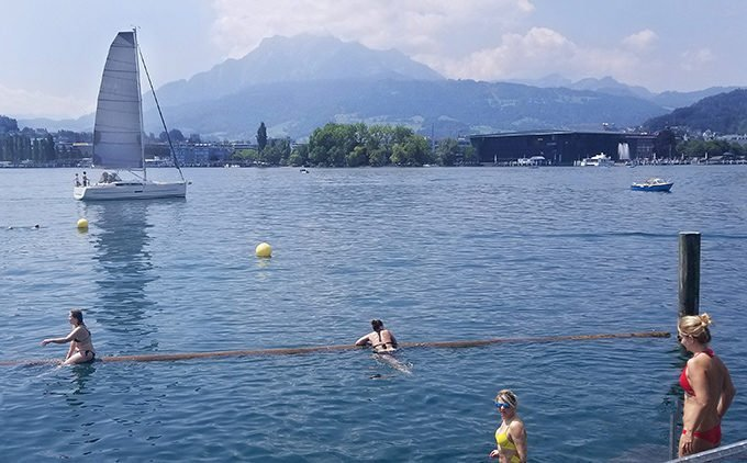 people swimming in lake lucerne