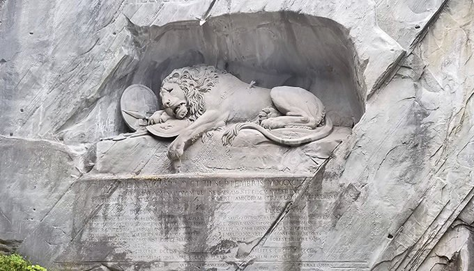 the Lion of Lucerne cut into a rock wall