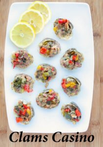 10 Clams Casino on a white plate with lemon slices