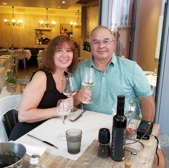 Chef Dennis and Lisa dining in a restaurant in Stresa, Italy