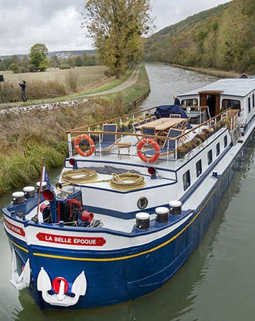 European Waterways barge cruising on a canal in Northern Burgundy France