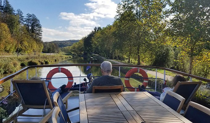 sitting on the deck of la Belle Epoque on a canal cruise in Norhern Burgundy