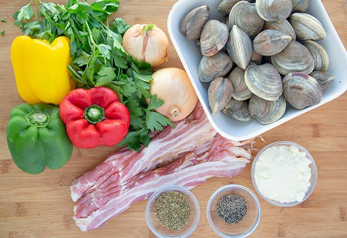 ingredients to make clams casino on a wooden cutting board