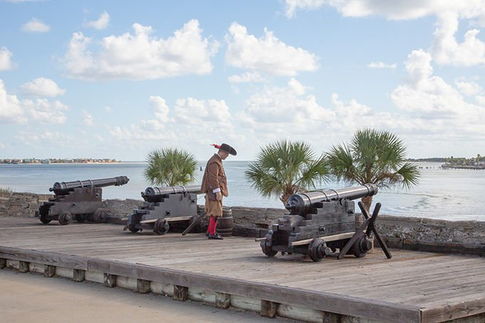 soldier with 3 cannons overlooking the river at Castillo de San Marcos in St. Augustine