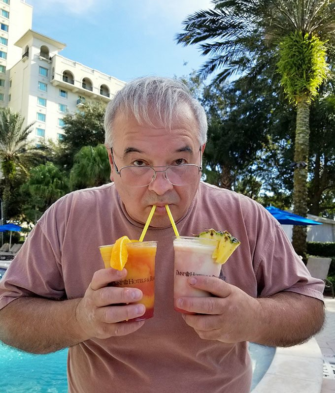 chef Dennis by the pool with two margaritas at the omni resort championsgate