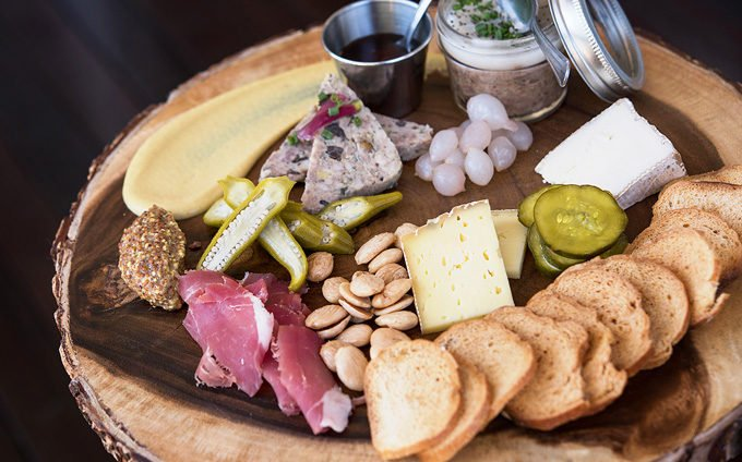 charcuterie on a wooden board at Preserved Restaurant