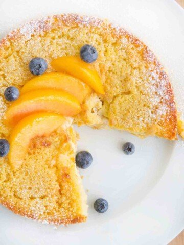 overhead view of peaches and cream breakfast cake with a slice cut out