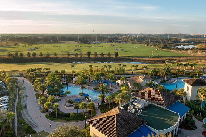 sunrise at the omni resort in orlando showing the pools and soccer fields
