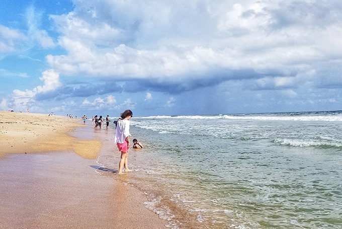 woman walking on St. Augustine beach on a perfect day
