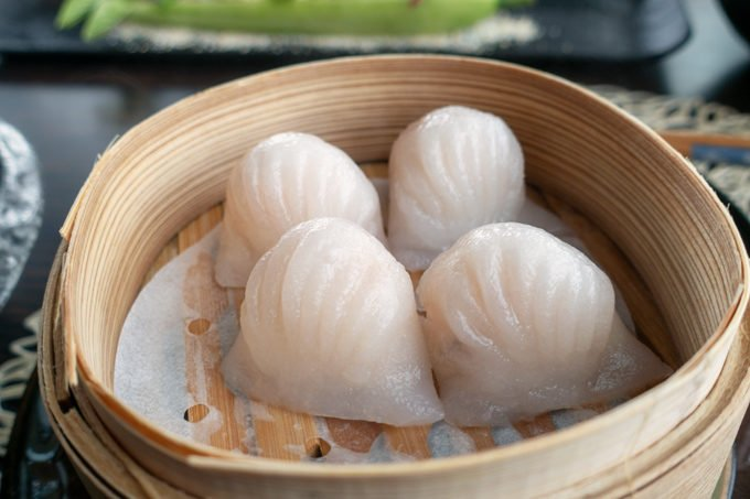 steamed crystal prawn dumplings in a bamboo steamer basket