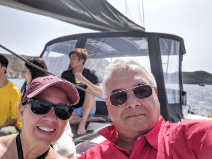 chef Dennis and Lisa on a boat