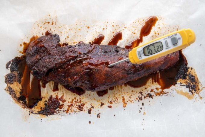 cooked barbecued pork tenderloin with meat thermometer