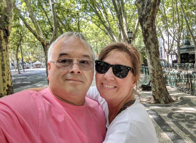 Chef Dennis and Lisa on the tree lined streets of Lisbon