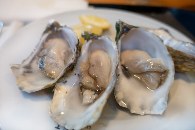 oysters on the half shell on a white plate
