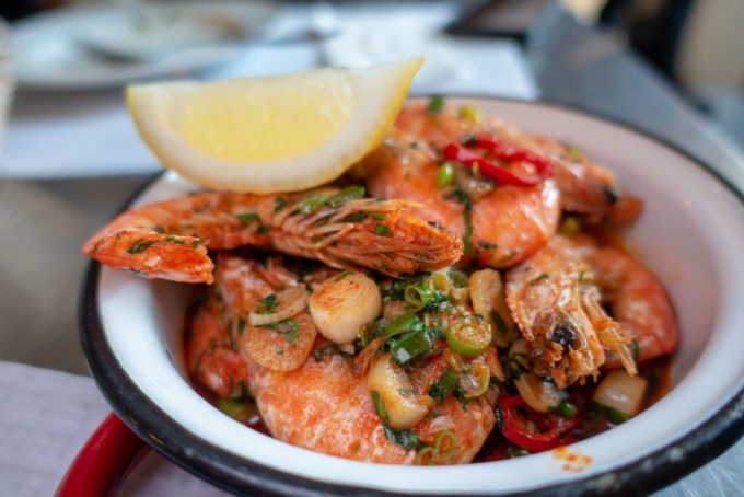 Garlic Shrimp with the shell on in a small bowl at Damas restaurant in Lisbon