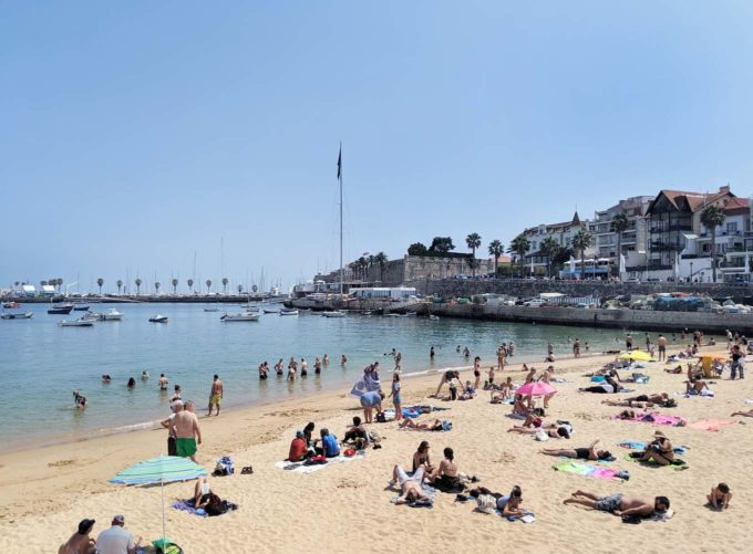 people on the beach in Cascais, Portugal