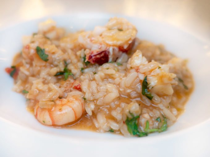 white bowl with seafood and rice, know as a rice bowl in Lisbon