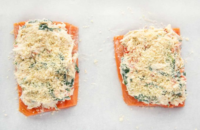 2 salmon fillets topped with crabmeat stuffing with panko bread crumbs on top