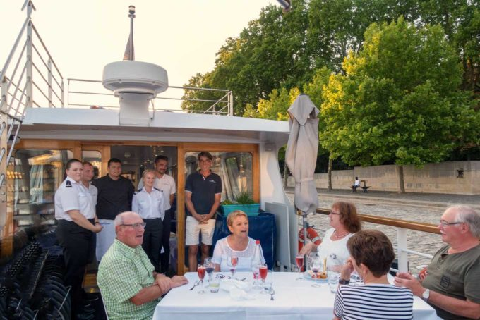 group of people and crew of Deborah on the back deck for dinner