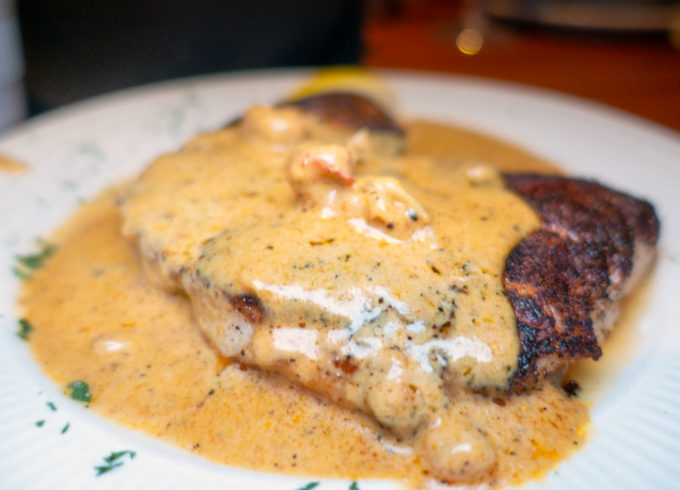 blackened grouper with crawfish in a cajun cream sauce