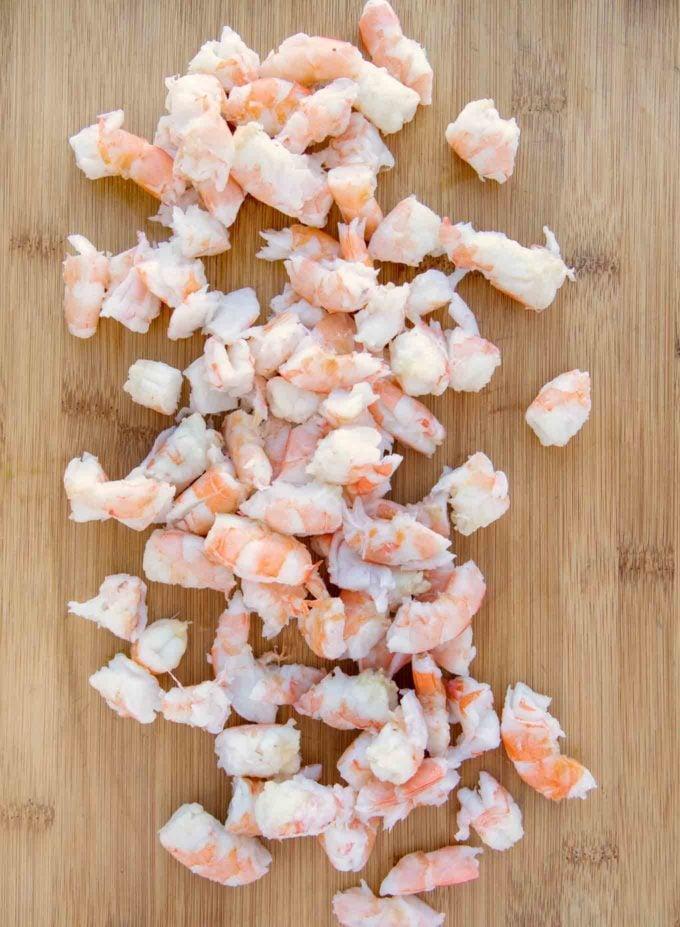 chopped shrimp on a cutting board